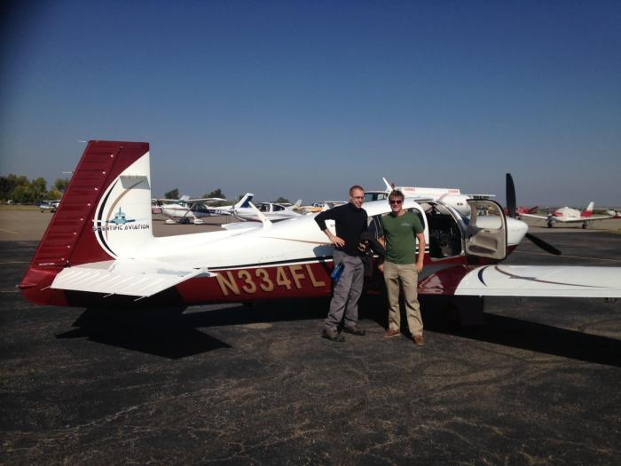 Me and pilot Bear Givhan in front of the Mooney Ovation aircraft