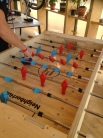 They used the spare wood from the construction to make a Foosball table!