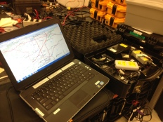 Jack's laptop with a program that predicts flight paths sitting next to a case full of tracking equipment.