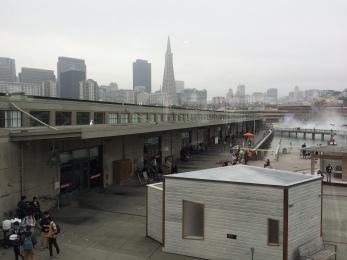 A view of Pier 15 from the Exploratorium's observatory, looking back towards the shore.