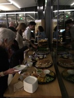 Larger public events sometimes come with a buffet spread and portable bar
