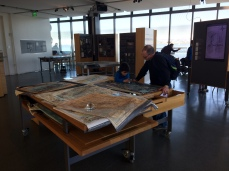 Lo-tech but popular is the map table featuring all kinds of maps of the bay