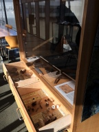 A collection of artifacts found when developing the reclaimed land filled in from the Bay.
