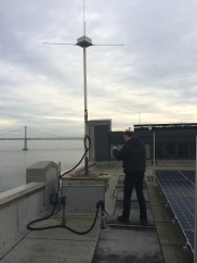 Ron inspects the base of the radar pole on the roof of the Exploratorium. Turns out it is in need of repair!