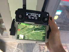 The drone controller with docked smartphone. You can use the drone without the smartphone app, but then you will be without a lot of useful functions, no less a live stream from the drone's camera and its GPS position.